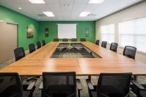 A meeting room with green accent walls.