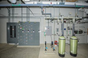 A room filled with electrical boxes and panels.