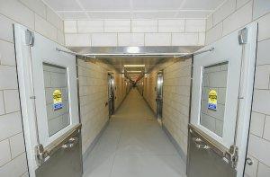 Tile hallway with metal doors.