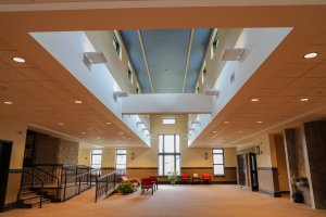 Entryway to a church with tall ceilings and drop tile.