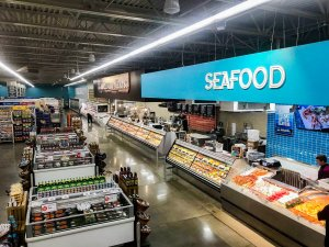 Seafood and meat counter of a grocery store.