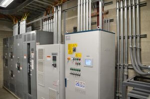 Electrical equipment inside of an electrical room.