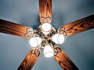 Photo of a ceiling fan with bright lights.