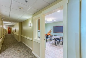 A photo of a hallway looking into a classroom.