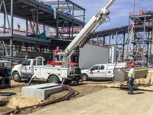 A Shaw Electric crew operates a crane at a job site.